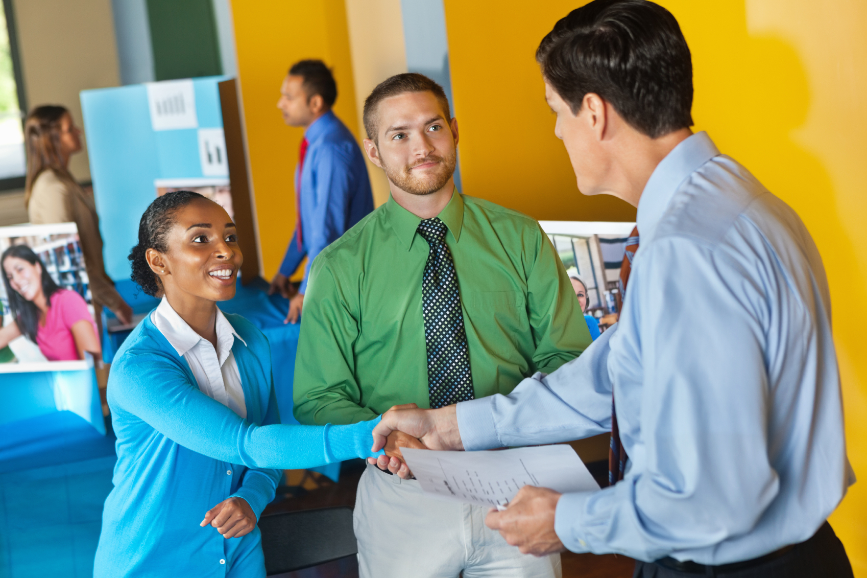 Recruitment event people shaking hands with employers